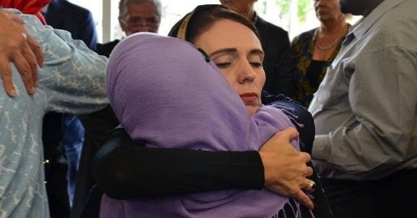 Newzealander PM Jacinda Ardern hugs a member of the grieved families