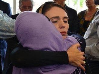 Newzealander PM Jacinda Ardern hugs a member of the grieved families